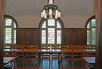 Dining hall with wood paneling and long wooden tables.