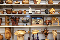 A variety of wood carvings on shelving.