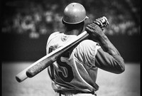 A baseball player seen from the rear.