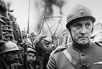 "A still from the film ""Paths of Glory,"" depicting Kirk Douglas and other actors in a WWI trench."