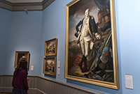 A portrait of John Trumbull hanging on a art gallery wall.