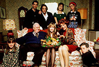 """A scene from the film """"Home for the Holidays,"""" with the cast members placed on and around a couch."""