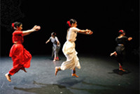 Four women performing an Indian classical dance.