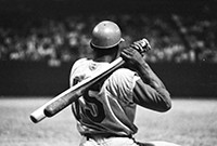 Baseball player Jackie Robinson seen from the rear.