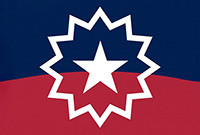 The logo of the Juneteenth Coalition which features a white star against a background of blue and red.