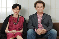A still from 'We Need to Talk About Kevin,' depicting a husband and wife sitting on a couch.