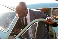 """A photo of a man entering a car, from the exhibiton """"Lazarus"""" by Jefferson Pinder."""