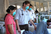 Three physicans work with AIDS patients in a South African hospital