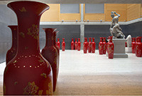 A photo of large, red porcelain vases on the floor of the Yale Center for British Art.