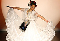 A female performing a Mexican folkloric dance.
