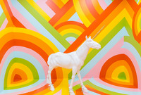 "The rainbow-walled ""unicorn room"" in the Museum of Ice Cream."