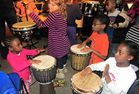 Children playing drums.