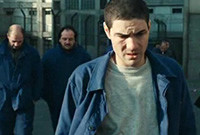 "A photo still of a prisoner from the movie ""Un Prophète."""