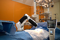 A robot performing surgery on a patient.