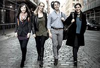 Member of the group Solera Quartet walking down the street.