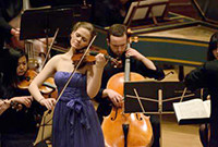 A female violinist and a male celloist in performance.
