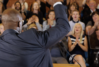 A Black politician giving a speech.