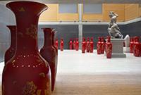 Red porcelain vases on the floor of the Yale Center for British Art.