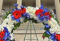 A wreath in front of a war memorial at Yale University.
