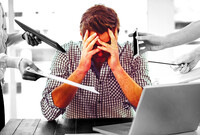 A man overcome by stress due to work
