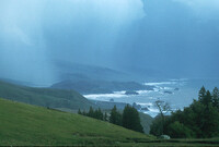A storm darkens the sky at the mouth of the Russian River, north of Bodega Bay, Calif.