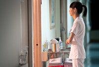 Healthcare provider standing at doorway