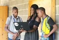 In Rwanda, Yale student instructor Elizabeth Olatunji '20 shows YYAS students how to access online university applications.